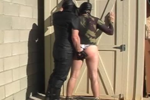 Masked males disrobe And slam Each Other outside