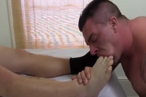Tattooed And pumped up Hunk Swallows His best Blokes Feet