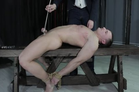 kinky chap tied Down, Balls Strung Up And Spanked