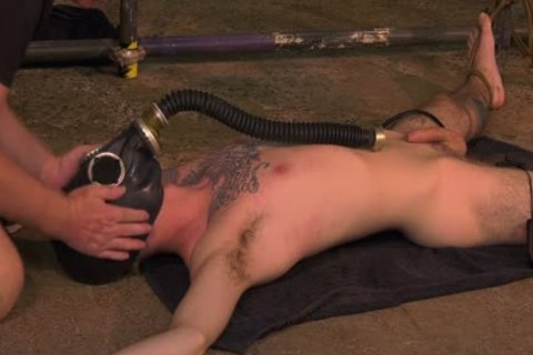 Roped Down twink receives A Gas Mask And A coarse cook jerking