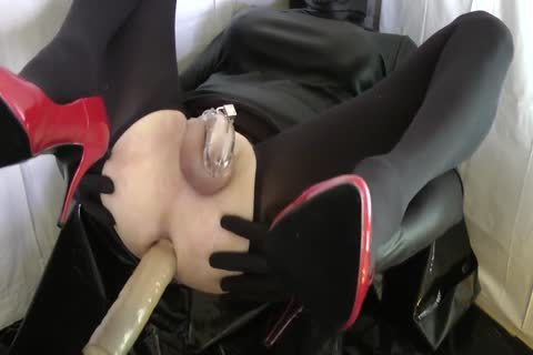 Sissy With Red Heels Is pounded In A Chastity Belt