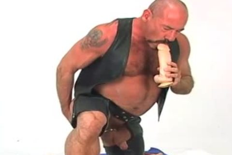 Butch leather wearing grandad w/ large sex-dildo